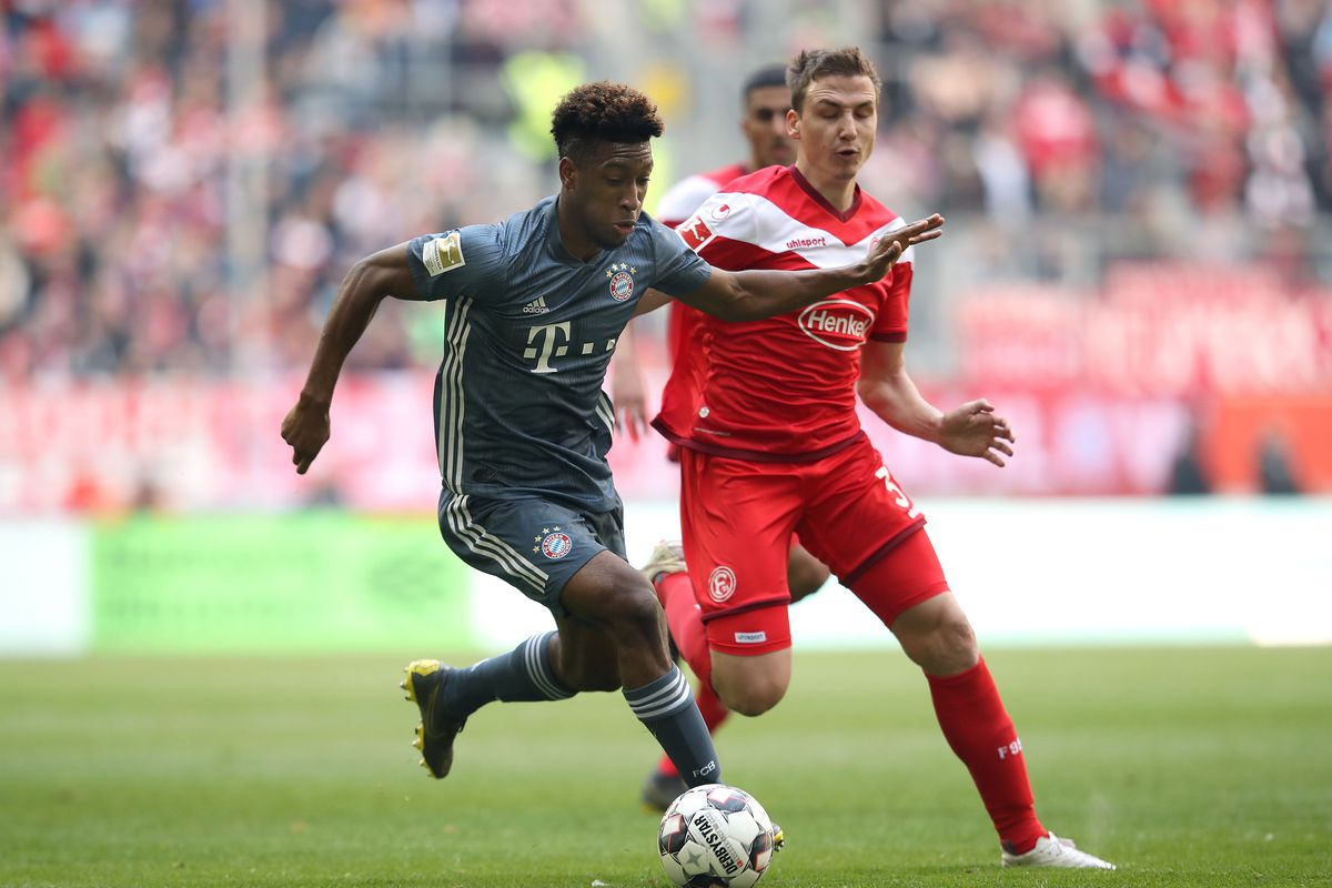 Bayern Munich's French defender Kingsley Coman (L) and Duesseldorf's German midfielder Marcel Sobottka (R) vie for the ball during the German first division Bundesliga football match Fortuna Duesseldorf and FC Bayern Munich in Duesseldorf, western Germany on April 14, 2019.