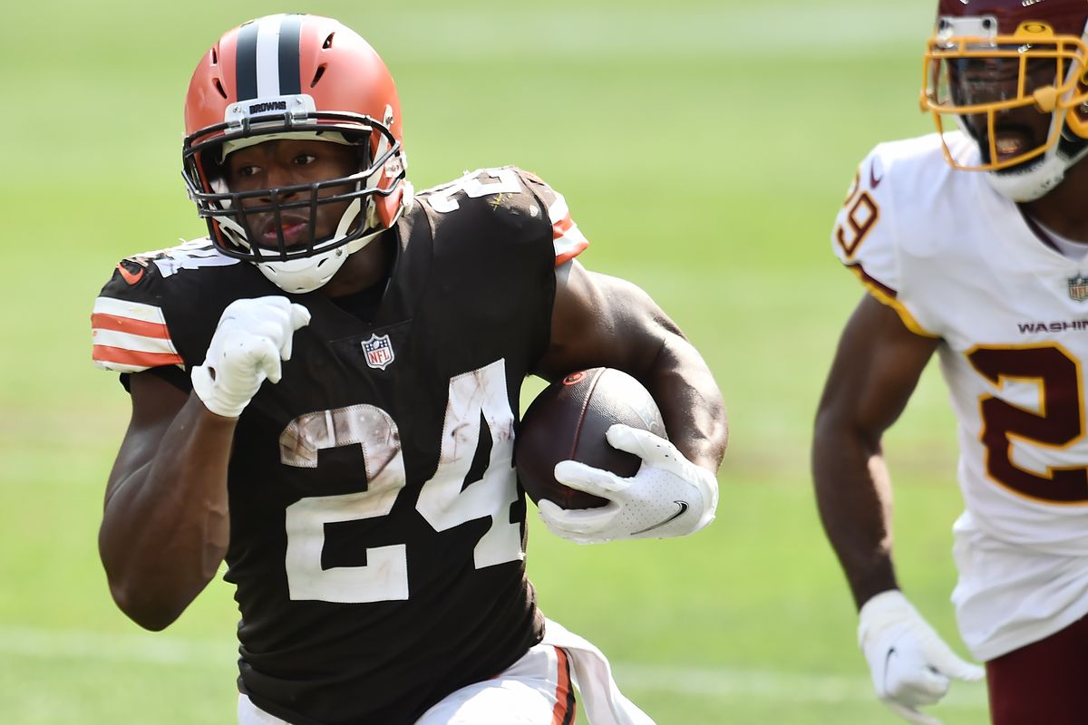 Cleveland Browns running back Nick Chubb (24) runs with the ball asWashington Football Team cornerback Kendall Fuller (29) defends during the second half at FirstEnergy Stadium.