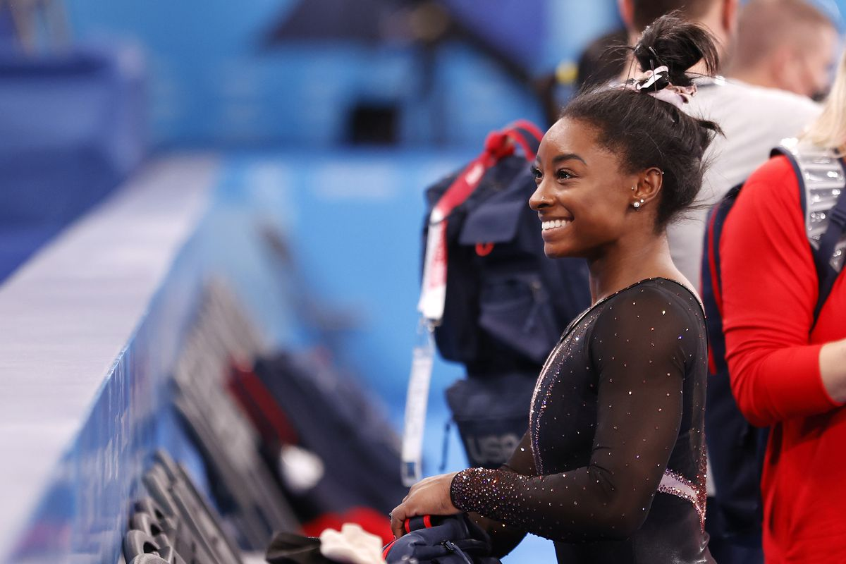 Simone Biles of Team United States reacts during Women's Podium Training ahead of the Tokyo 2020 Olympic Games at Ariake Gymnastics Centre on July 22, 2021 in Tokyo, Japan.