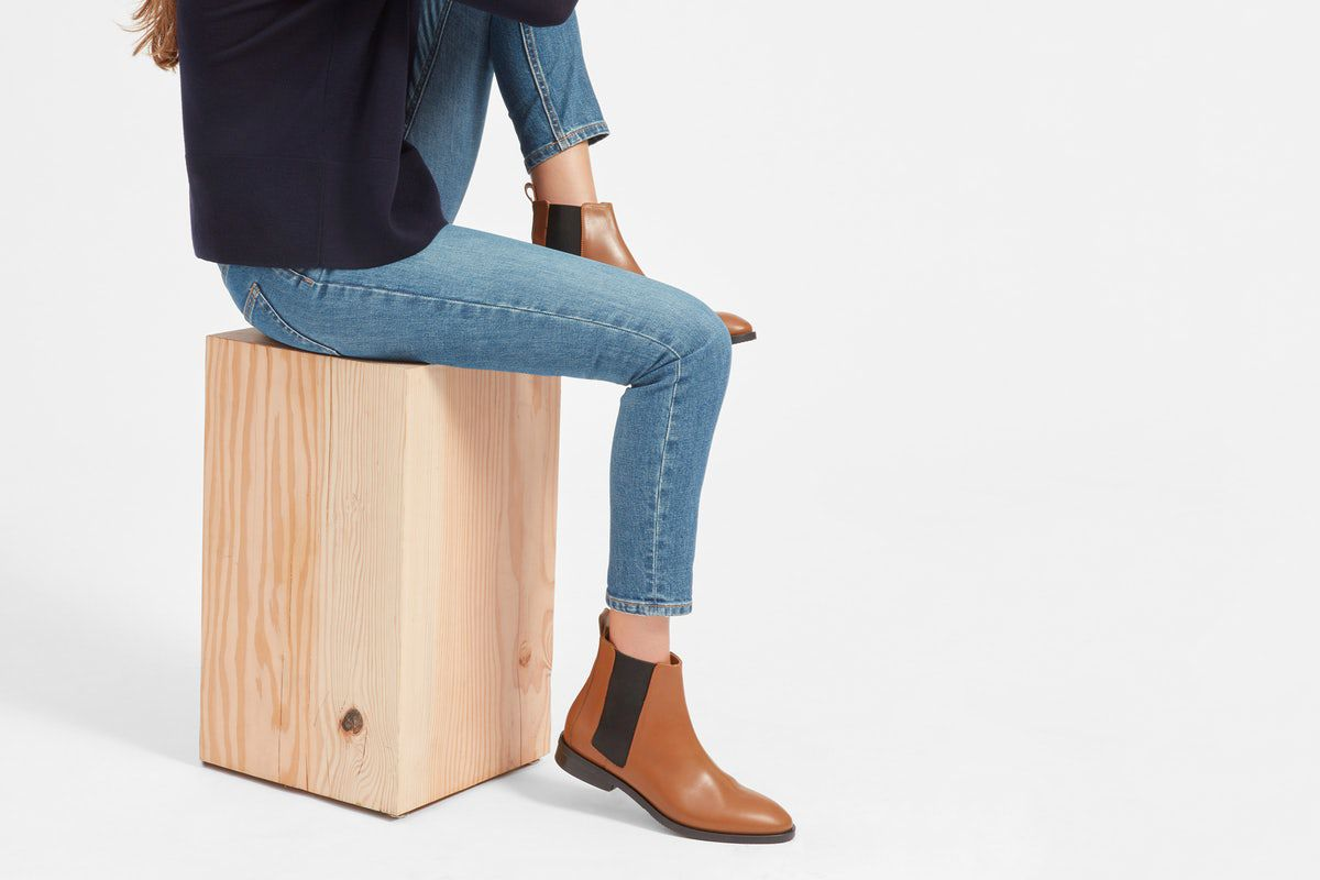 A woman in jeans and Chelsea boots.