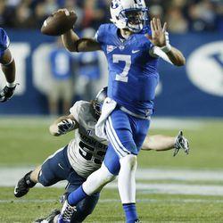 Utah State Aggies linebacker Zach Vigil (53) hurries Brigham Young Cougars quarterback Christian Stewart (7) in Provo Saturday, Oct. 4, 2014. USU won 35-20.