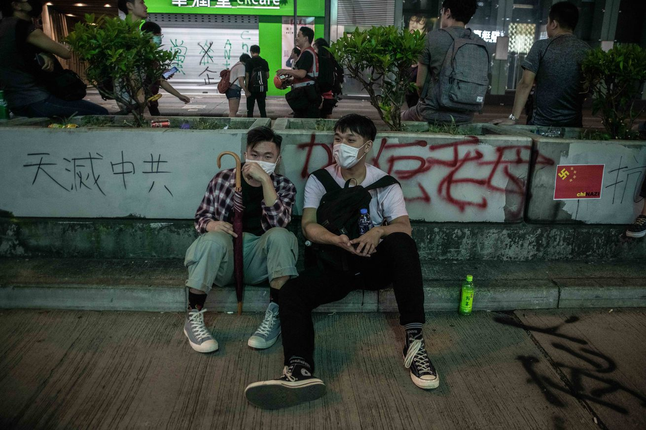 Protesters rest after a blockage on Nathan Road during the...