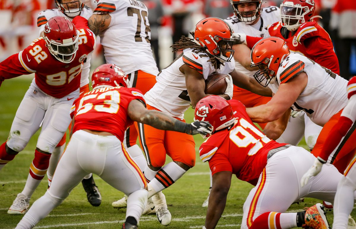 Kareem Hunt #27 of the Cleveland Browns runs with the football in the third quarter past Anthony Hitchens #53 of the Kansas City Chiefs in the AFC Divisional Playoff at Arrowhead Stadium on January 17, 2021 in Kansas City, Missouri.