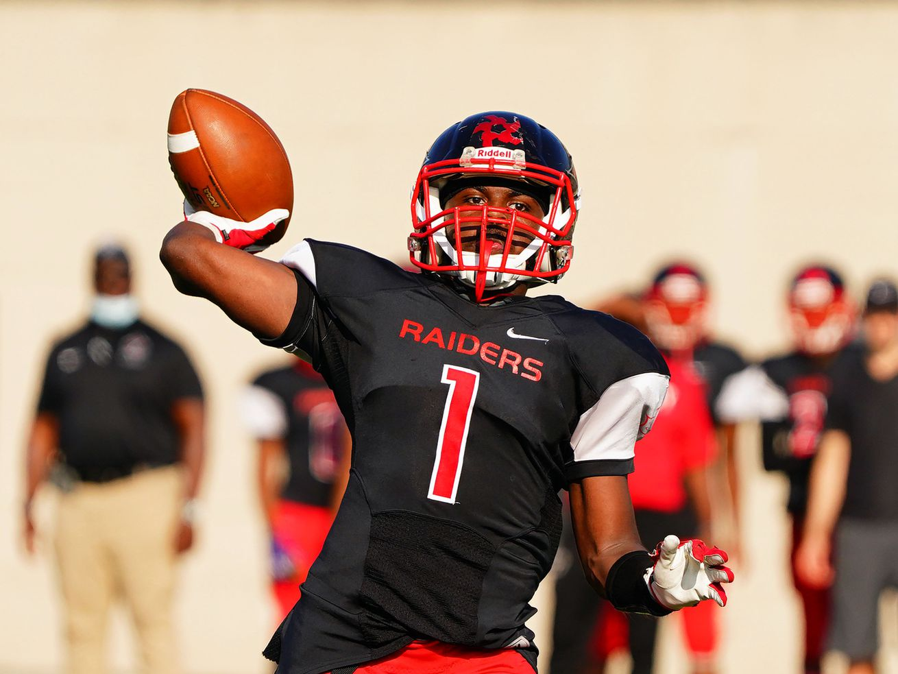 Raby's Kierre Turner (1) completes the two point conversion against Clark.