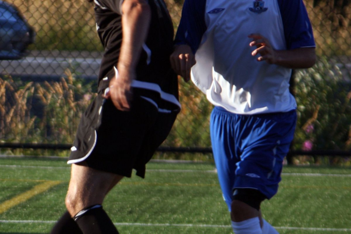 Victoria Highlanders striker Riley O'Neill, left, tries to outplay FC Edmonton fullback Paul Hamilton in a friendly match at City Centre Park on August 8, 2010. (Benjamin Massey/The Maple Leaf Forever)
