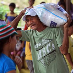 Residents in Tacloban receive goods from the Salvation Army, Friday, Nov. 22, 2013.
