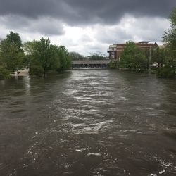 The DuPage River overflowed its banks and flooded portions of the Naperville Riverwalk Monday, May 18, 2020.