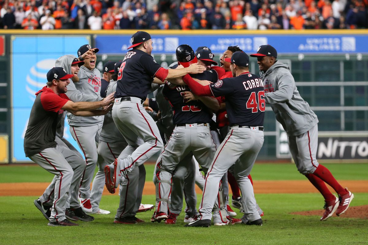 Washington Nationals players celebrate on the field after defeating the Houston Astros in game seven of the 2019 World Series at Minute Maid Park. The Washington Nationals won the World Series winning four games to three.