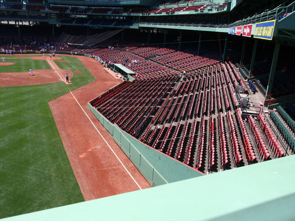 An empty ballpark with lots of rows of seats.