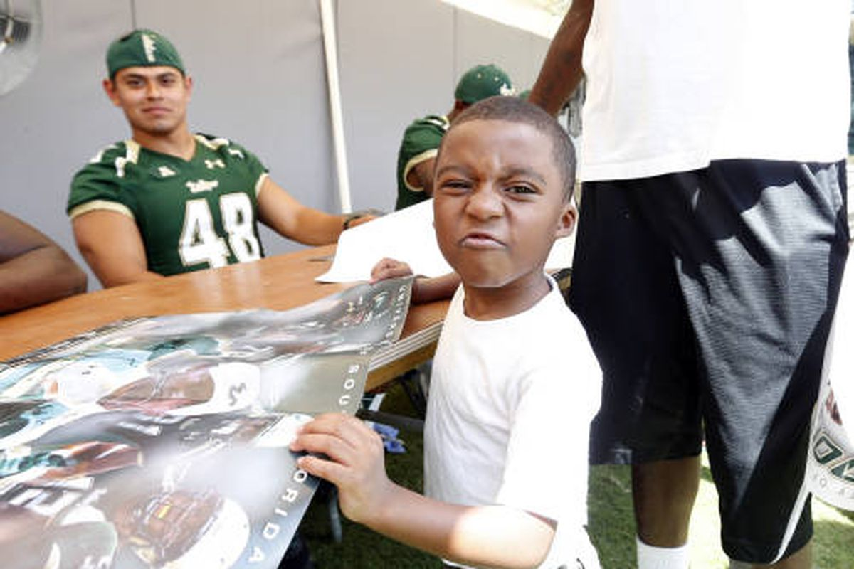 This young fan wasn't saddened by the rain at Fan Fest on Saturday