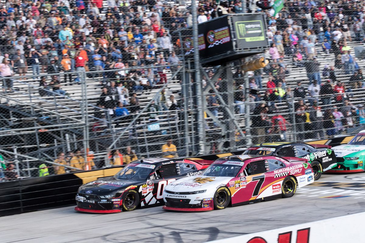 Stewart-Haas Racing driver Cole Custer #00 races side by side JR Motorsports driver Justin Allgaier #7 down the front stretch during the Use Your Melon Drive Sober 200 NASCAR Xfinity Series Playoff Race on October 05, 2019, at Dover International Speedway in Dover, DE.