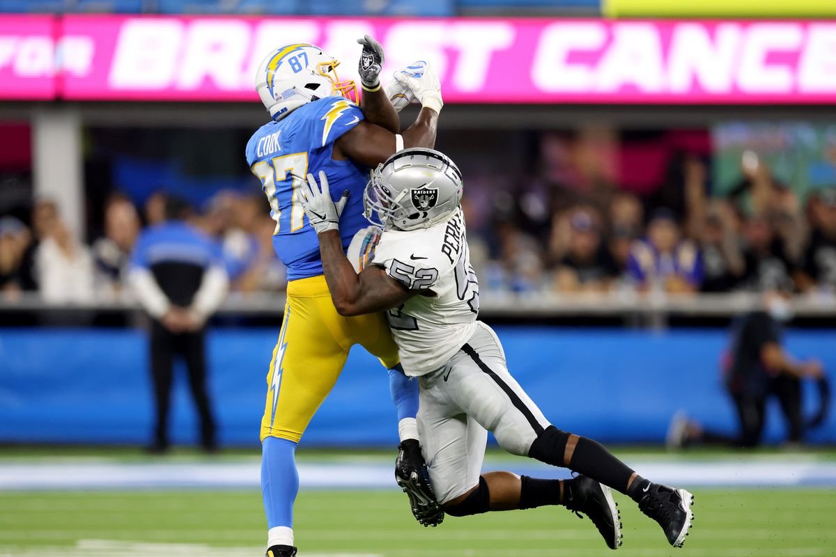 Jared Cook #87 of the Los Angeles Chargers makes a catch for a first down behind Denzel Perryman #52 during a 28-14 win over the Las Vegas Raiders at SoFi Stadium on October 04, 2021 in Inglewood, California.