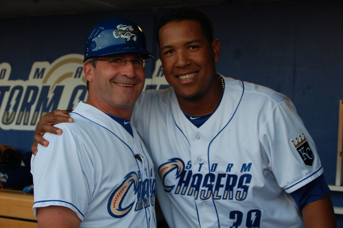 Former Omaha manager Mike Jirschele (left) poses with former Omaha catcher Salvador Perez (right)