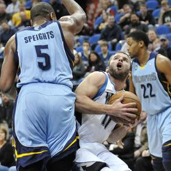 Minnesota Timberwolves' J.J. Barea (11) looks to shoot as Memphis Grizzlies' Marreese Speights (5) looms over him in the first half of an NBA basketball game Tuesday, April 17, 2012, in Minneapolis.