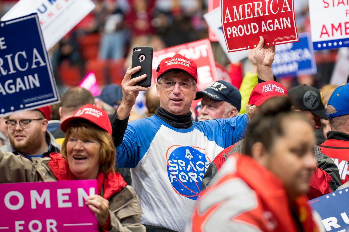 A man at a Trump rally wearing a Space Force t-shirt and taking a selfie