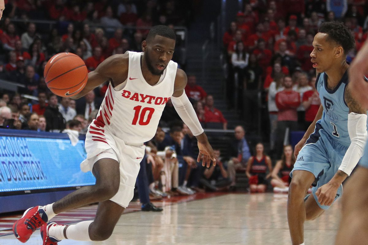 Dayton Flyers guard Jalen Crutcher drives against Rhode Island Rams guard Fatts Russell during the second half at University of Dayton Arena.