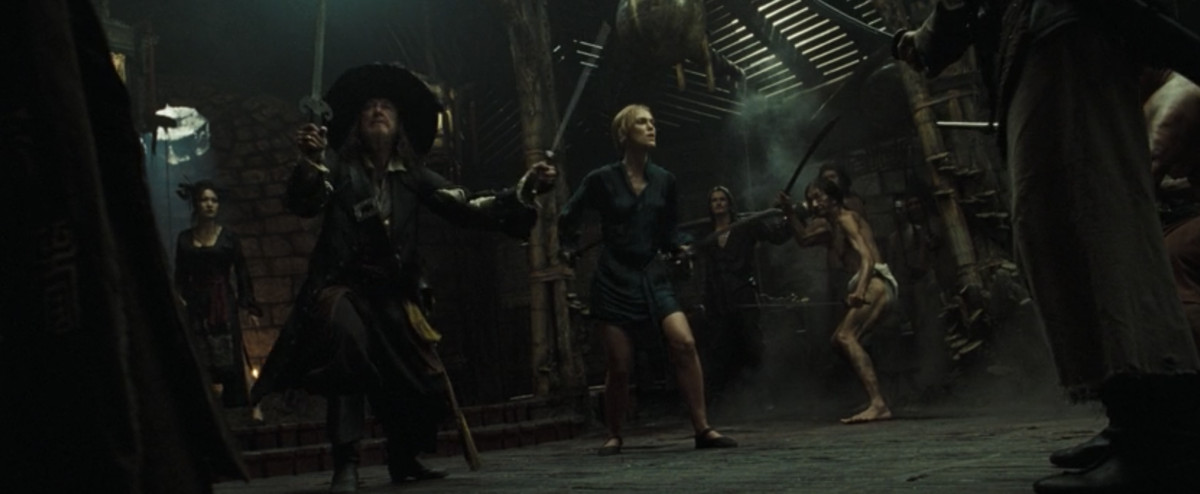 Elizabeth and Barbossa in the bath house with swords