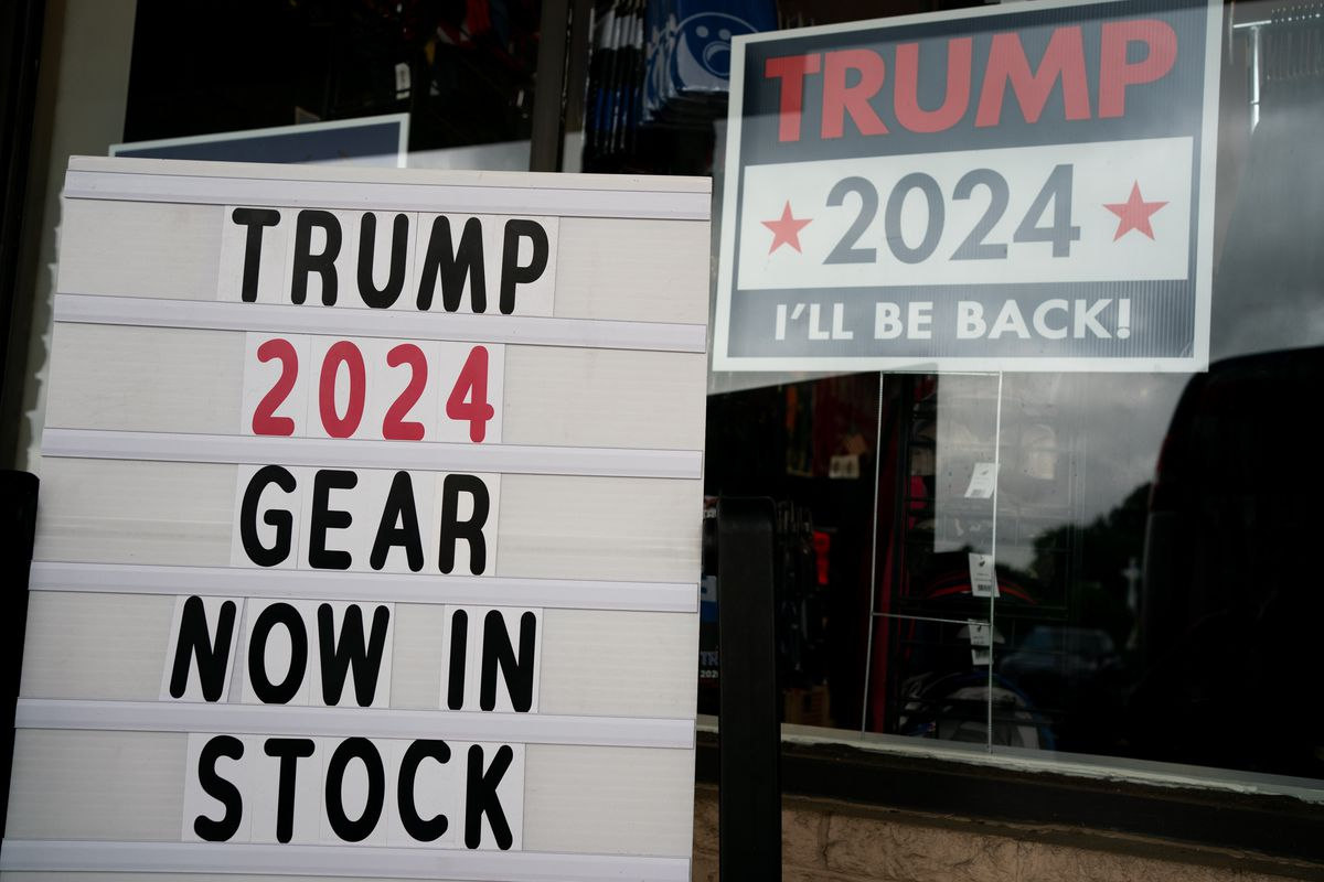 """Signs outside The Trump Store read """"Trump 2024 Gear Now in Stock"""" and """"Trump 2024 I'll Be Back!"""" in Penn., on Thursday, Sep. 9, 2021."""