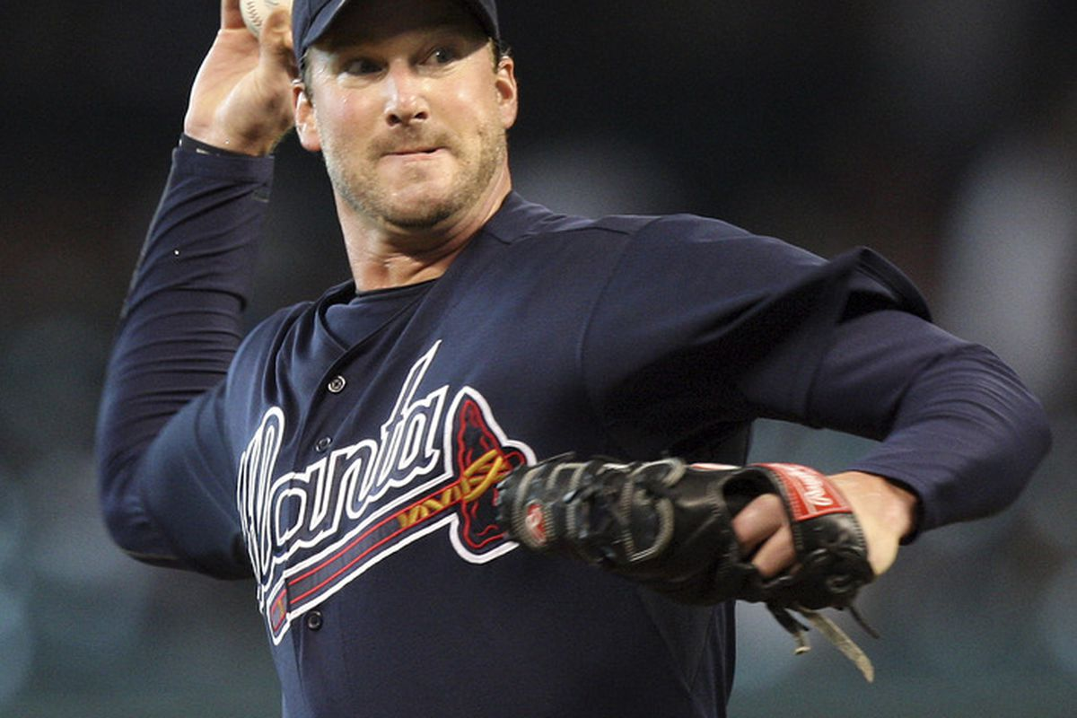 HOUSTON - JUNE 13:  Pitcher Derek Lowe #32 of the Atlanta Braves throws against the Houston Astros in the first inning at Minute Maid Park on June 13, 2011 in Houston, Texas.  (Photo by Bob Levey/Getty Images)