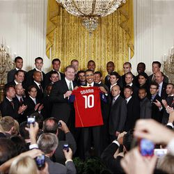 President Barack Obama holds a jersey with Real Salt Lake team co-owner Dave Checketts during a ceremony in the East Room of the White House where he honored the  Major League Soccer champions.