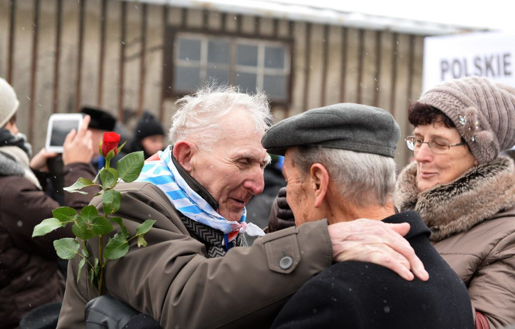 <small><strong>Holocaust survivors greet each others as they arrive to pay tribute to fallen comrades in the former Auschwitz concentration camp in Oswiecim, Poland, on the 70th anniversary of the liberation of the Nazi death camp. | Janek Skarzynski / Ge