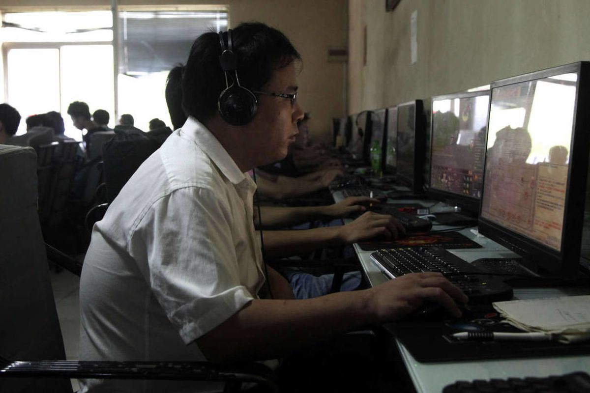 In this photo taken Wednesday, July 14, 2010, a Chinese man uses a computer at an Internet cafe in Beijing, China.