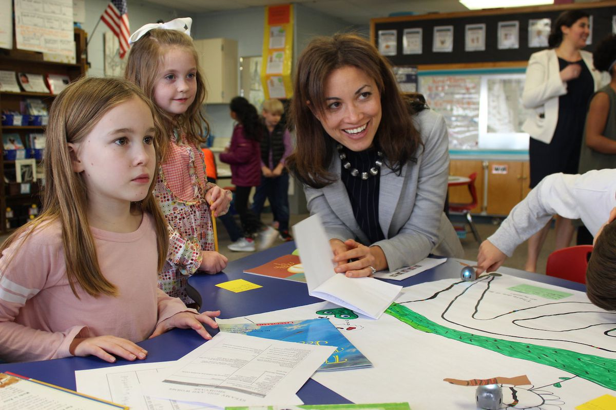 Penny Schwinn visits with students at a school in Rutherford County in February, soon after becoming education commissioner in Tennessee. (Photo courtesy of Tennessee Department of Education)