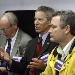 Mayor Ralph Becker talks with the policy group at the temporary emergency operations center for Salt Lake City at Washington Square during The Great Utah ShakeOut, Tuesday, April 17, 2012. At left is Ed Rutan, city attorney. At right is Soren Simonsen, Salt Lake City Council Chair.