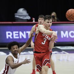 Utah guard Pelle Larsson passes the ball while pressured by Washington State guard Myles Warren during the second half of an NCAA college basketball game in Pullman, Wash., Thursday, Jan. 21, 2021.