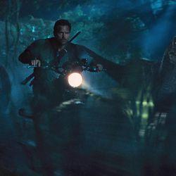"Chris Pratt is surrounded by raptors in ""Jurassic World."""