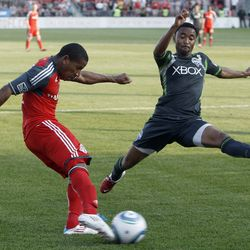 TORONTO, CANADA - JUNE 18: Joao Plata #7 of Toronto FC shoots past James Riley #7 of Seattle Sounders FC during MLS action at BMO Field June 18, 2011 in Toronto, Ontario, Canada. (Photo by Abelimages/Getty Images)