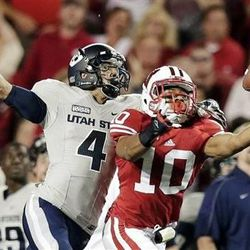 Wisconsin's Devin Smith (10) breaks up a pass intended for Utah State's Matt Austin (4) during the first half of an NCAA college football game, Saturday, Sept. 15, 2012, in Madison, Wis. (AP Photo/Morry Gash)