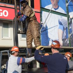 5:24 p.m. The statue being lifted over the pedestal -