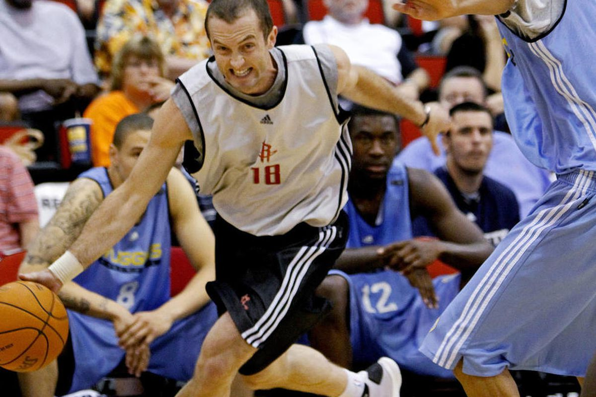 Houston Rockets\' Blake Ahearn (18) drives past Denver Nuggets\' Romel Beck during an NBA summer league basketball game in Las Vegas on Wednesday, July 14, 2010.\r\n