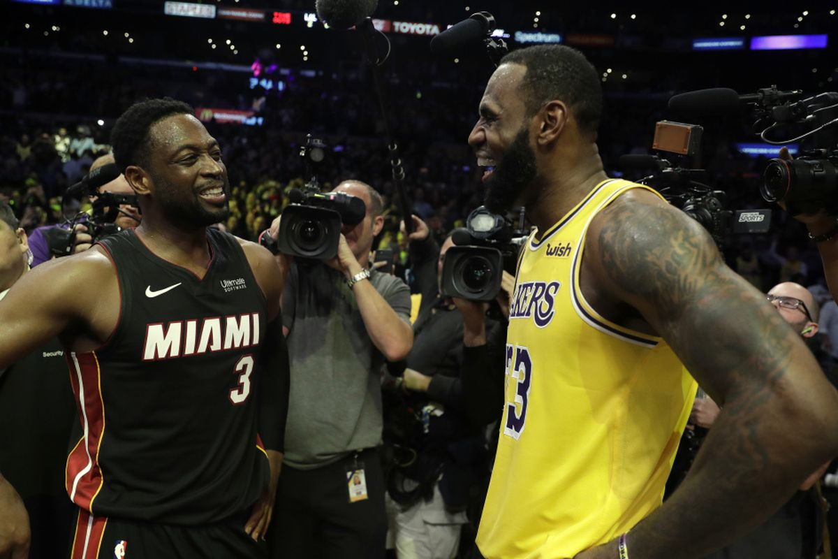 ec96ecc4cbd Los Angeles Lakers' LeBron James, right, talks to Miami Heat's Dwyane Wade  after an NBA basketball game Monday, Dec. 10, 2018, in Los Angeles.