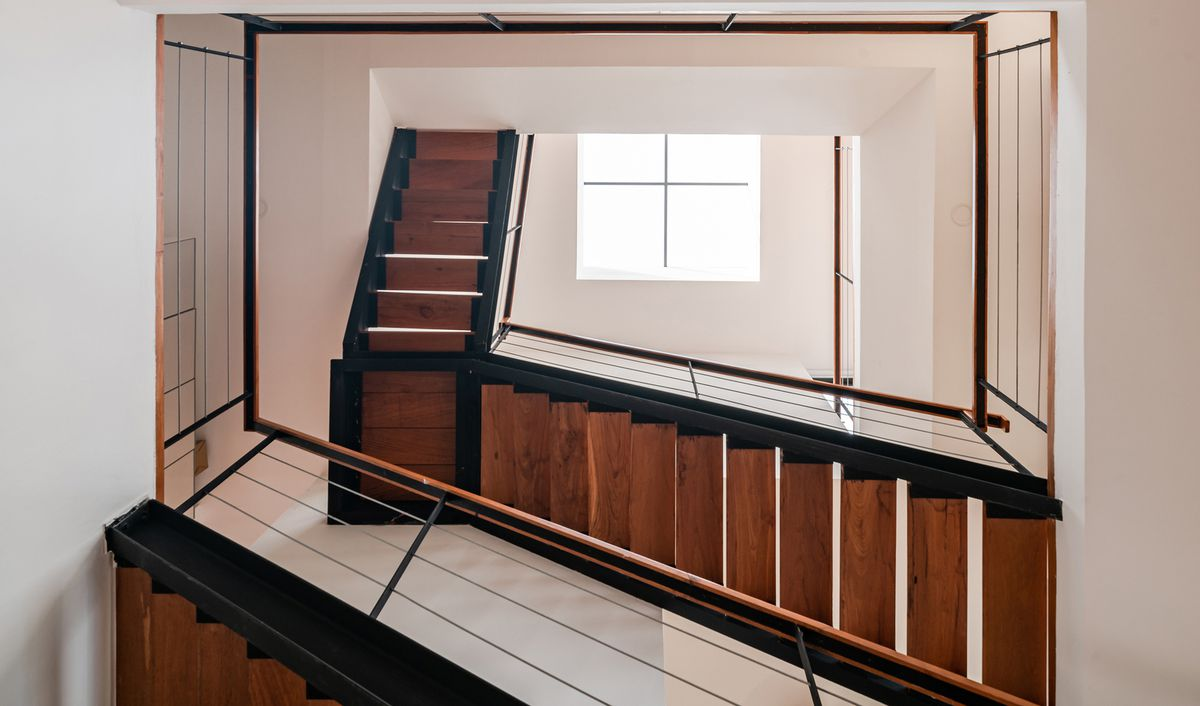 View of stairs creating an atrium inside house.