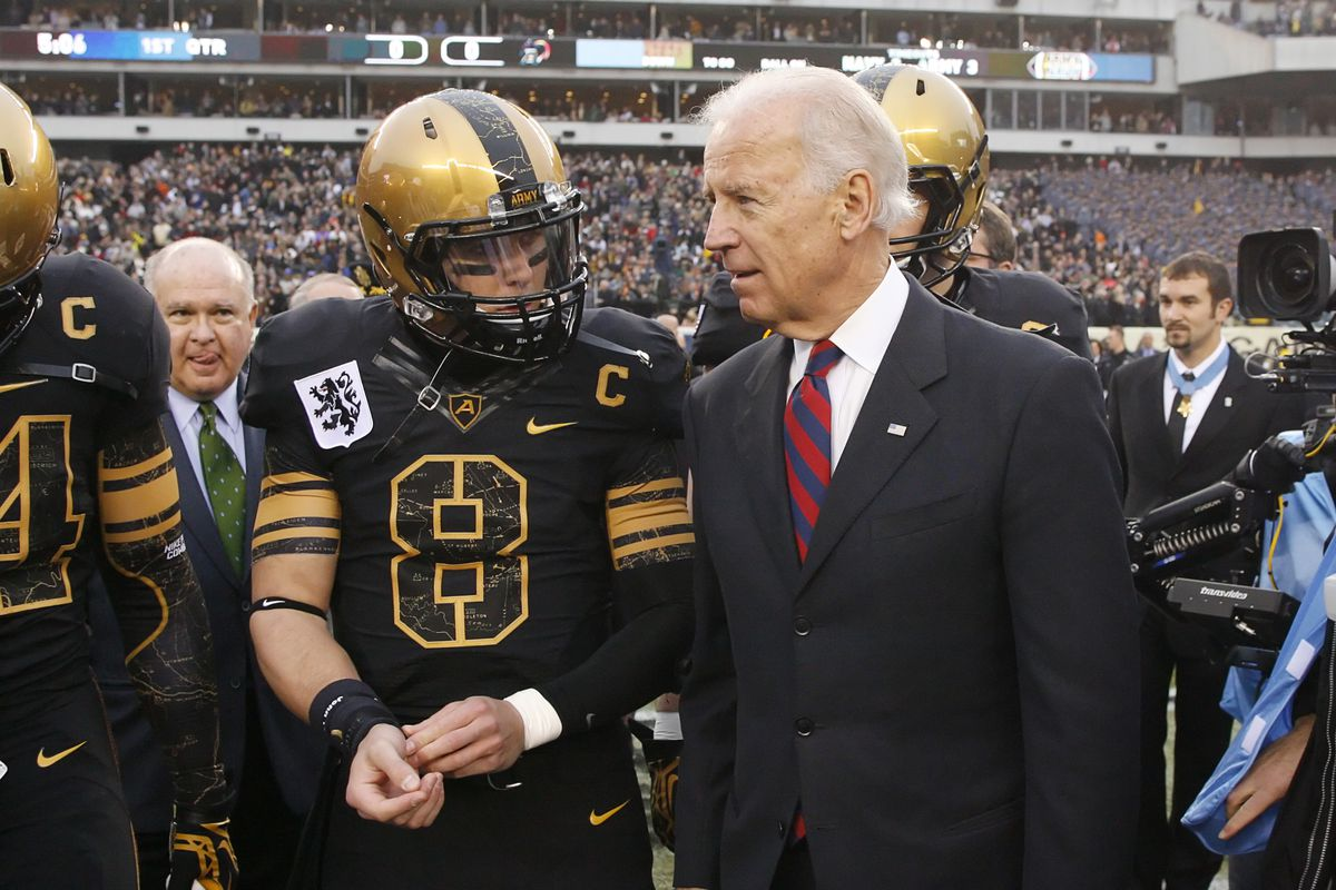 Trent Steelman of the Army Black Knights speaks with Vice President of the United States Joe Biden before a game against the Navy Midshipmen on December 8, 2012 at Lincoln Financial Field in Philadelphia, Pennsylvania.