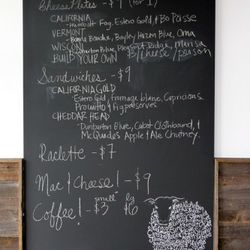 The chalkboard menu will list the daily specials. As of today there are two sandwiches, raclette, mac & cheese and cheese plates.