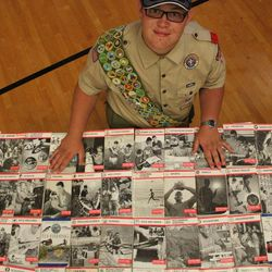 Nate Christensen stands with all of his merit badge booklets. He completed 132 merit badges in the Boy Scouts of America scouting program. He also happens to be autistic.