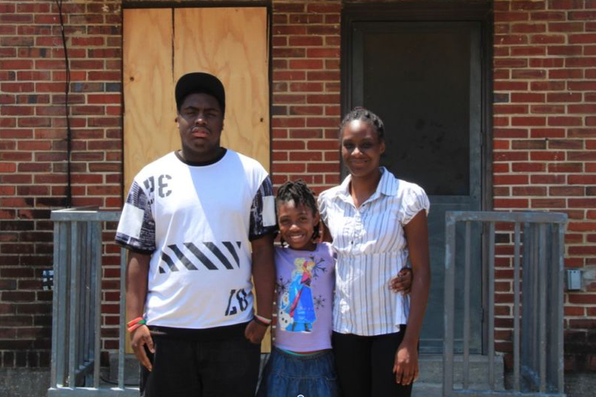 Tiara Edmond (right) and her children Jamal, 16, and Joemaya, 9, stand outside their apartment in the Foote Homes housing project.
