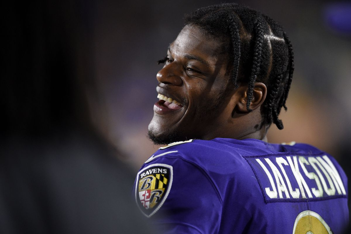 Baltimore Ravens quarterback Lamar Jackson laughs from the sidelines during the second half against the Los Angeles Rams at Los Angeles Memorial Coliseum.
