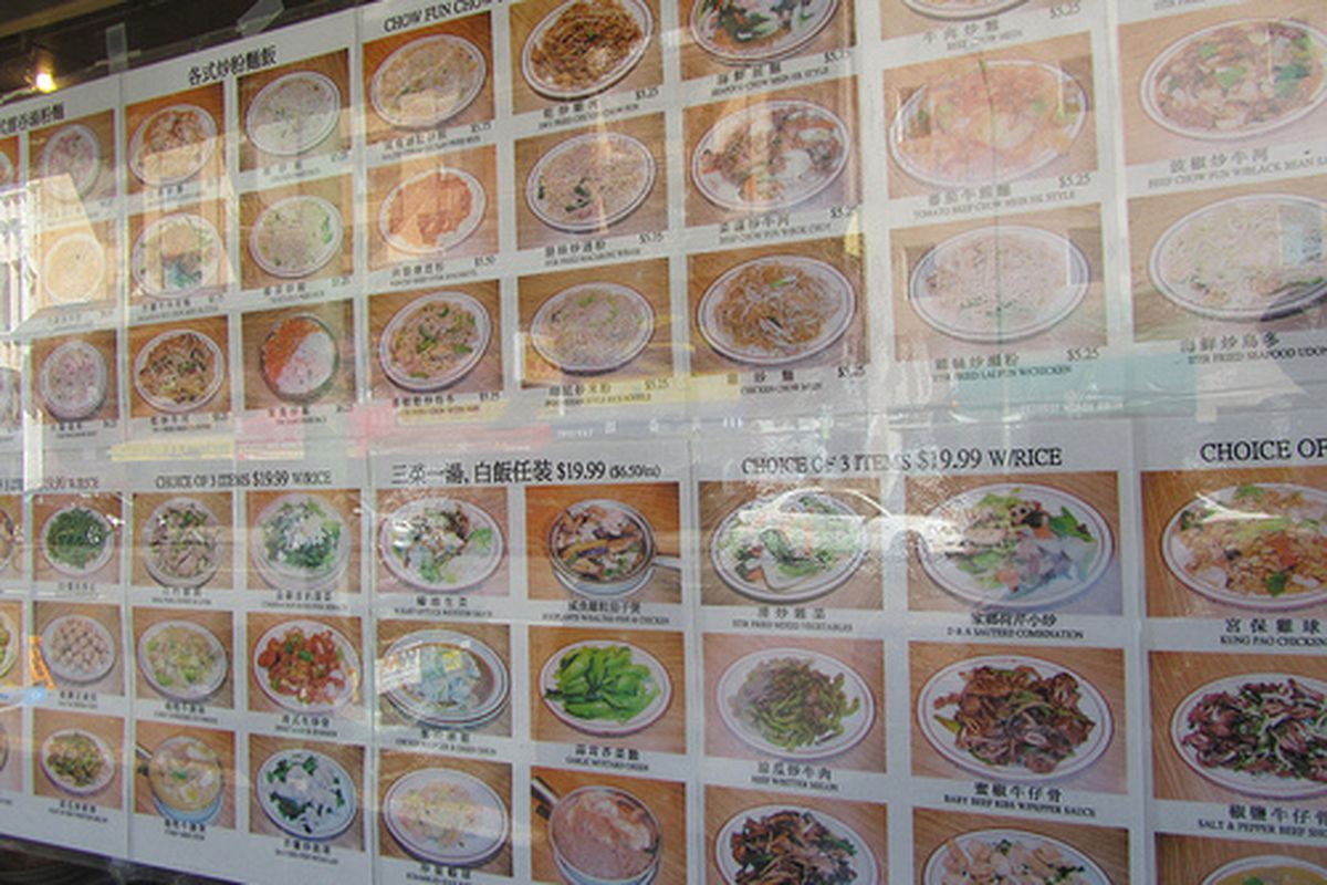 Signs for dishes in Oakland's Chinatown.
