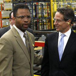 FILE - In this April 4, 2012 file photo, Treasury Secretary Timothy Geithner, right, and Rep Jesse Jackson Jr., D-Ill. tour the Ford Motor Company Stamping Plant in Chicago Heights, Ill. With the November election only five weeks away, Jackson's absence from work and the campaign trail is testing patience in Chicago. His GOP opponent is now criticizing him for it after pledging not to. Friendly editorial writers are now urging he come forward and finally explain himself. And Jackson's alderman wife, Sandi, is having to deny in public that she might step in to replace him. The Jackson camp says only that the congressman is still on the ballot and will only return to work when cleared for that by a doctor, but the uncertainty and mystery is feeding talk of what happens if he resigns and needs to be replaced, a process with a sordid history in Chicago and Illinois.