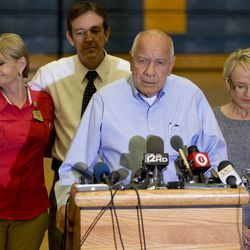Joined by Arizona Gov. Jan Brewer, Prescott, Ariz., Mayor Marlin Kuykendall answers questions during a news conference, Monday, July 1, 2013 in Prescott, Ariz. An out-of-control blaze overtook an elite group of firefighters trained to battle the fiercest wildfires, killing 19 members as they tried to protect themselves from the flames under fire-resistant shields. The disaster Sunday afternoon all but wiped out the 20-member Hotshot fire crew leaving the city's fire department reeling.(AP Photo/Julie Jacobson)