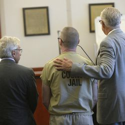 Defense attorneys Mark Moffat, left, and Jim Bradshaw, right, flank Craig Crawford, center, as he pleads guilty in the death of John Williams, his estranged husband, during an appearance in Judge Vernice Trease's 3rd District courtroom in Salt Lake City on Tuesday, June 27, 2017. Crawford admitted to trapping the prominent restaurateur in his home and setting it ablaze, killing him.