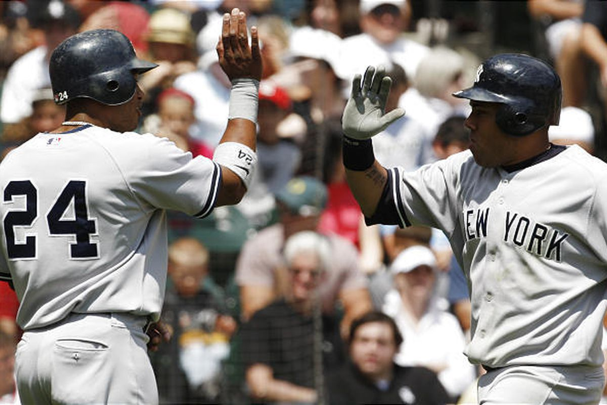 New York Yankees' Melky Cabrera, right, celebrates with Robinson Cano after hitting a three-run home run against the Chicago White Sox during the second inning of a baseball game in Chicago Sunday.
