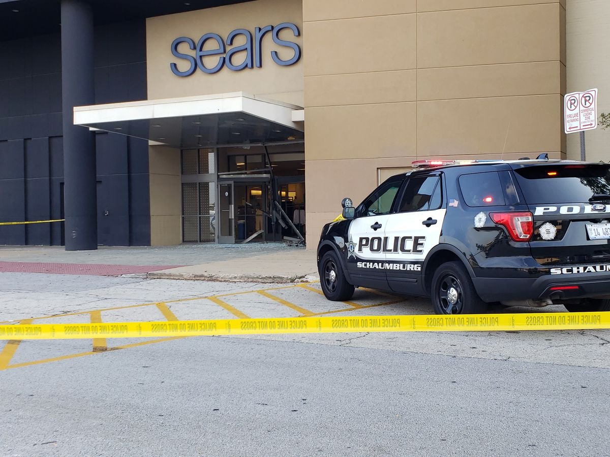 A police SUV sits outside Sears Friday at Woodfield Mall.