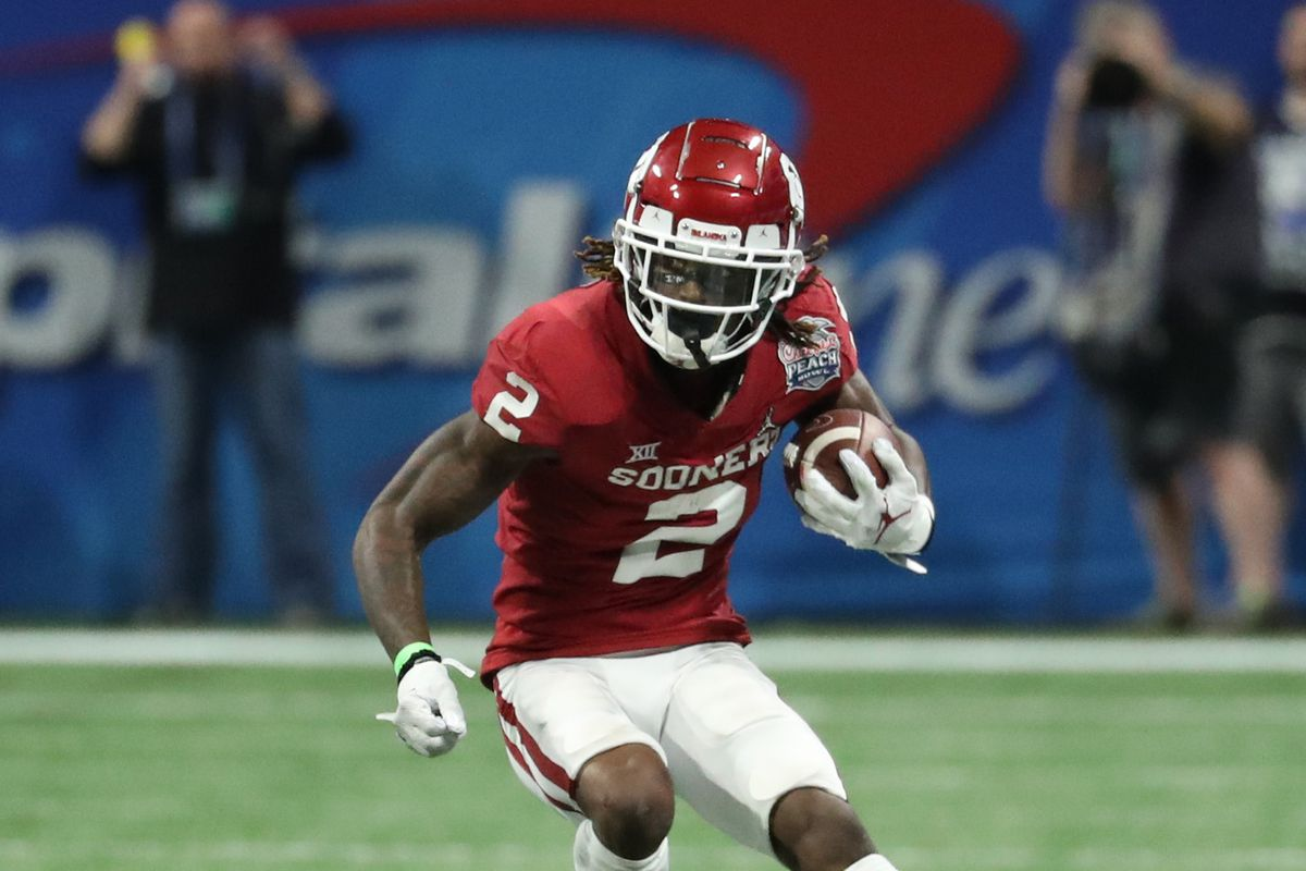 Oklahoma Sooners wide receiver CeeDee Lamb runs after a catch during the 2019 Peach Bowl college football playoff semifinal game between the LSU Tigers and the Oklahoma Sooners at Mercedes-Benz Stadium.