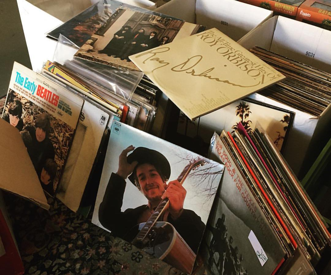 Stacks of records with Bob Dylan's Nashville Skyline in front