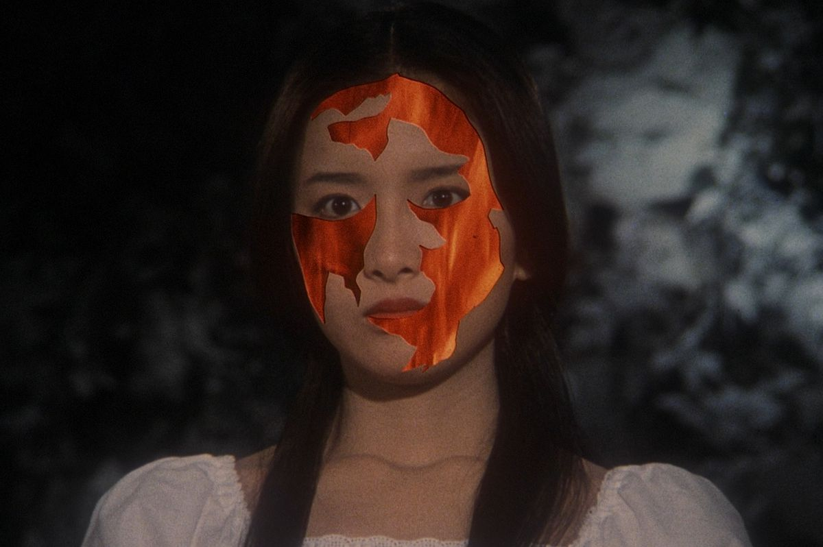 A woman's face with some of the skin replaced with a fiery video effect in 1977's House